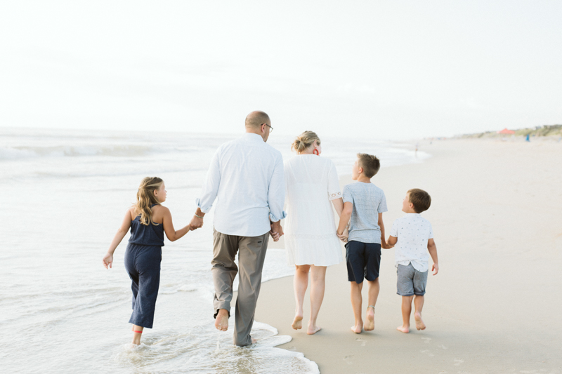 family walking down the beach